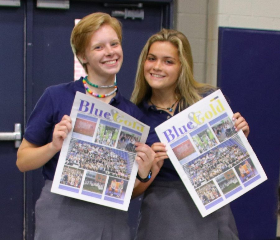 Lauren Jennings 19 and Jenna Monnin 19, former editors, pose with the print newspaper at the Activities Fair.