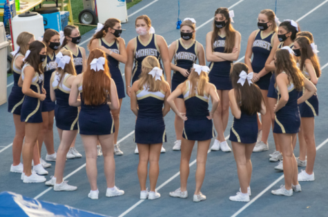 "The Varsity Cheerleaders sport their ""Marist Cheerleading"" masks at every football game"