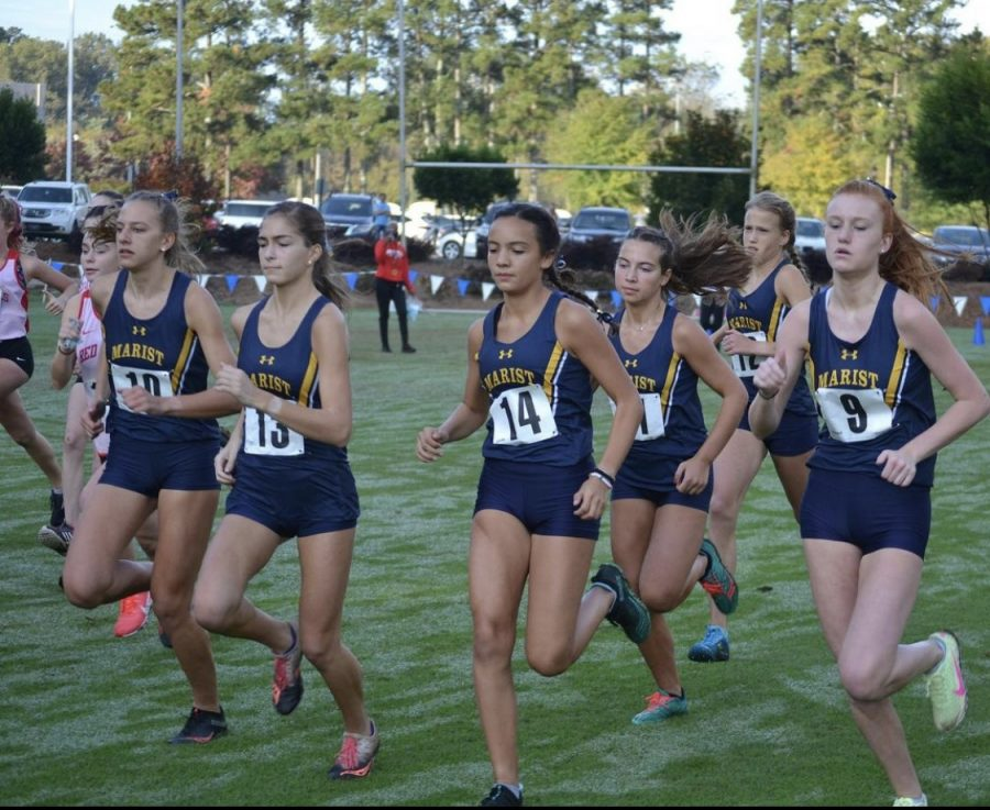 Girls XC teams competing together on the Marist course