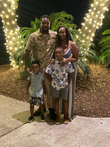 Mrs. Scott with her husband and two children