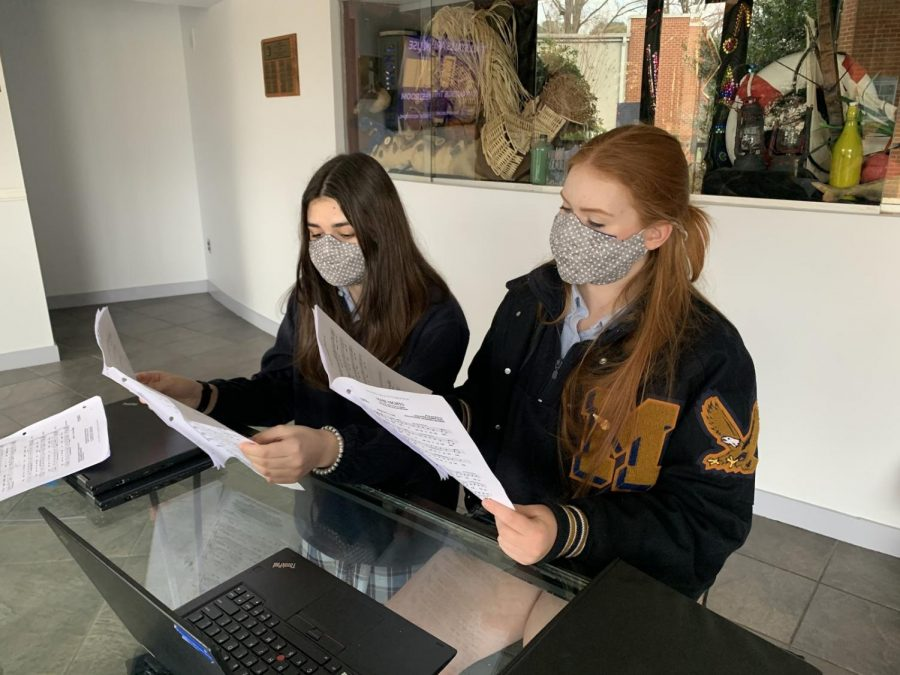 Sophie Frank '23 and Ellie Erwin '22 rehearse their vocal section for the