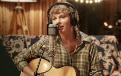 """Swift recording one of her songs in """"folklore: the long pond studio session"""" on Disney+"""