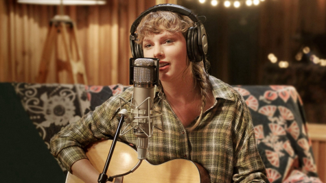 "Swift recording one of her songs in ""folklore: the long pond studio session"" on Disney+"