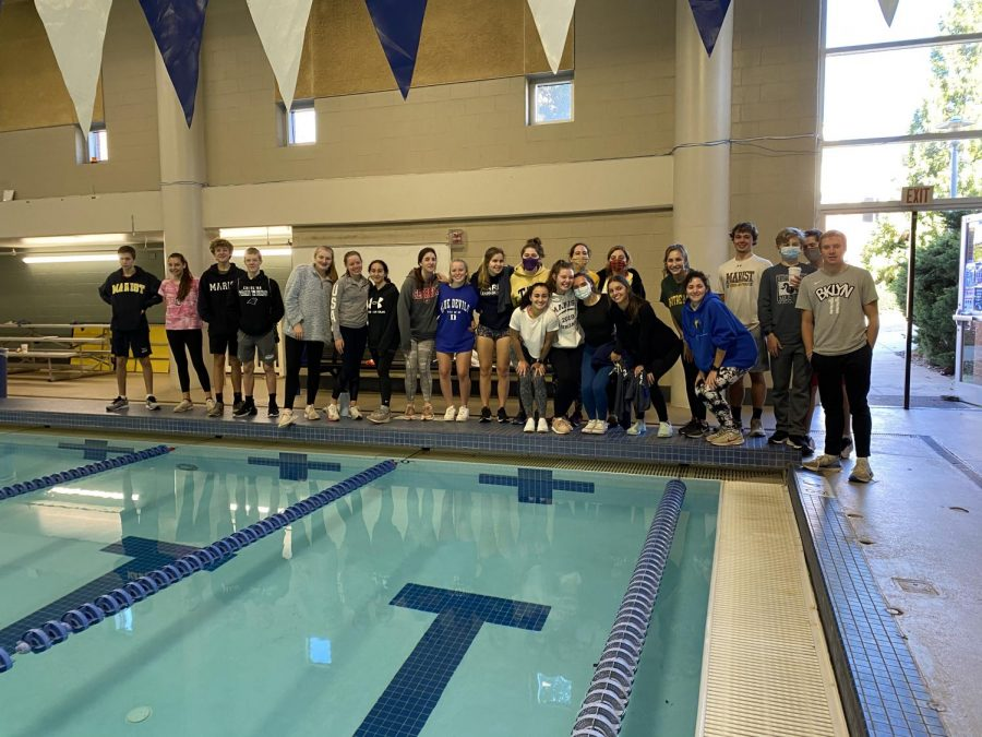 Members of the Boys and Girls Swim & Dive Teams before practice