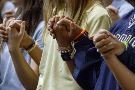 Marist students pray together at a (pre-COVID) Mass.